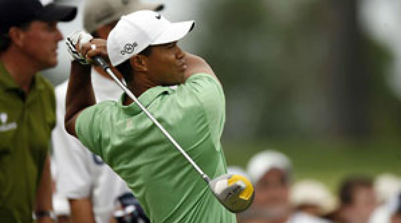 Tiger Woods made five birdies, four bogeys and an eagle.