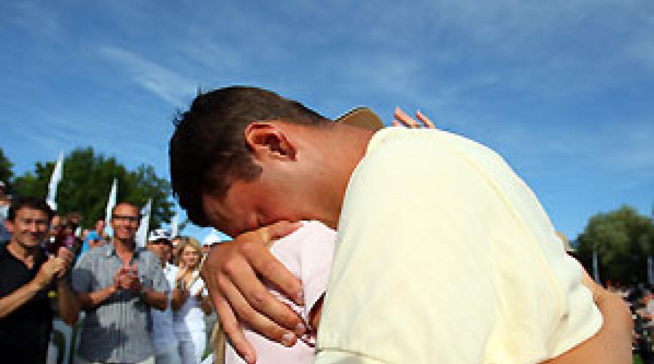 Martin Kaymer hugged his girlfriend Jenny as he bursts into tears after winning The BMW International Open Golf Sunday.
