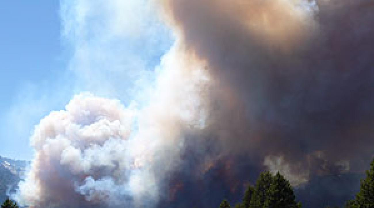 FIRE ALARM On Sunday, golfers at Lake Tahoe Golf Course in South Lake                 Tahoe, Calif., finished up as a forest fire loomed. Only two hours old then, the blaze had torched 2,500 acres and 250 houses by Monday afternoon.