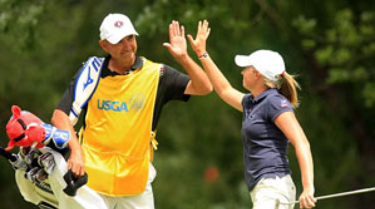 Stacy Lewis celebrated with her father/caddie after making one of six birdies on the day. Lewis leads by one.