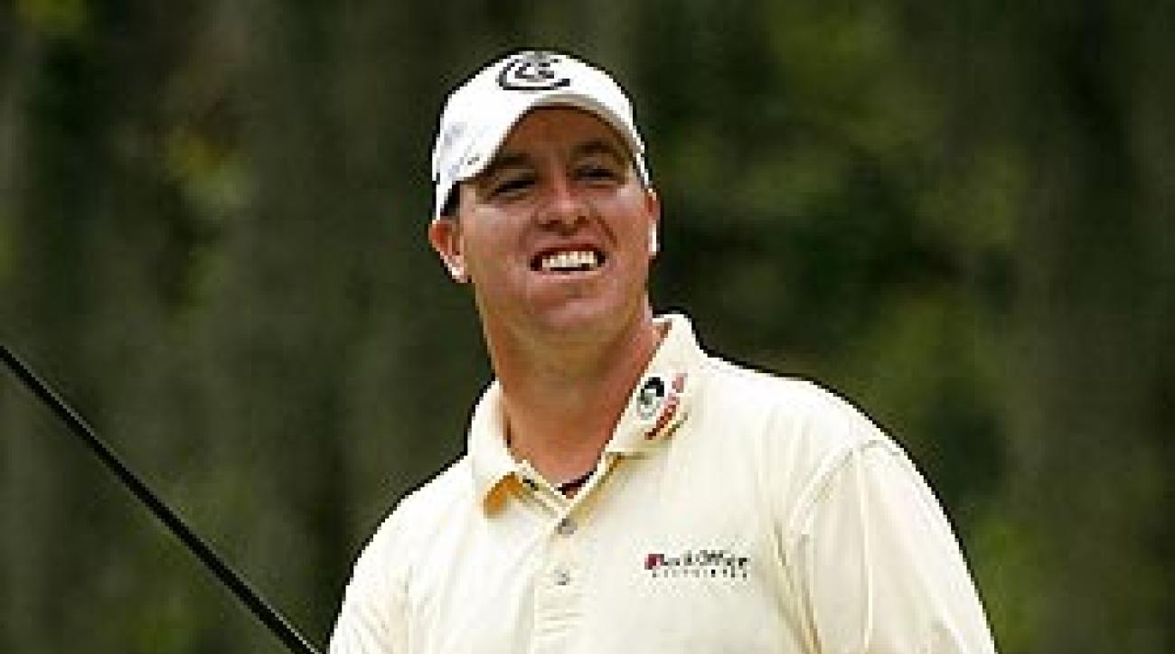 Weekley's wad of chew and the offal it produces share the limelight when he's in contention.