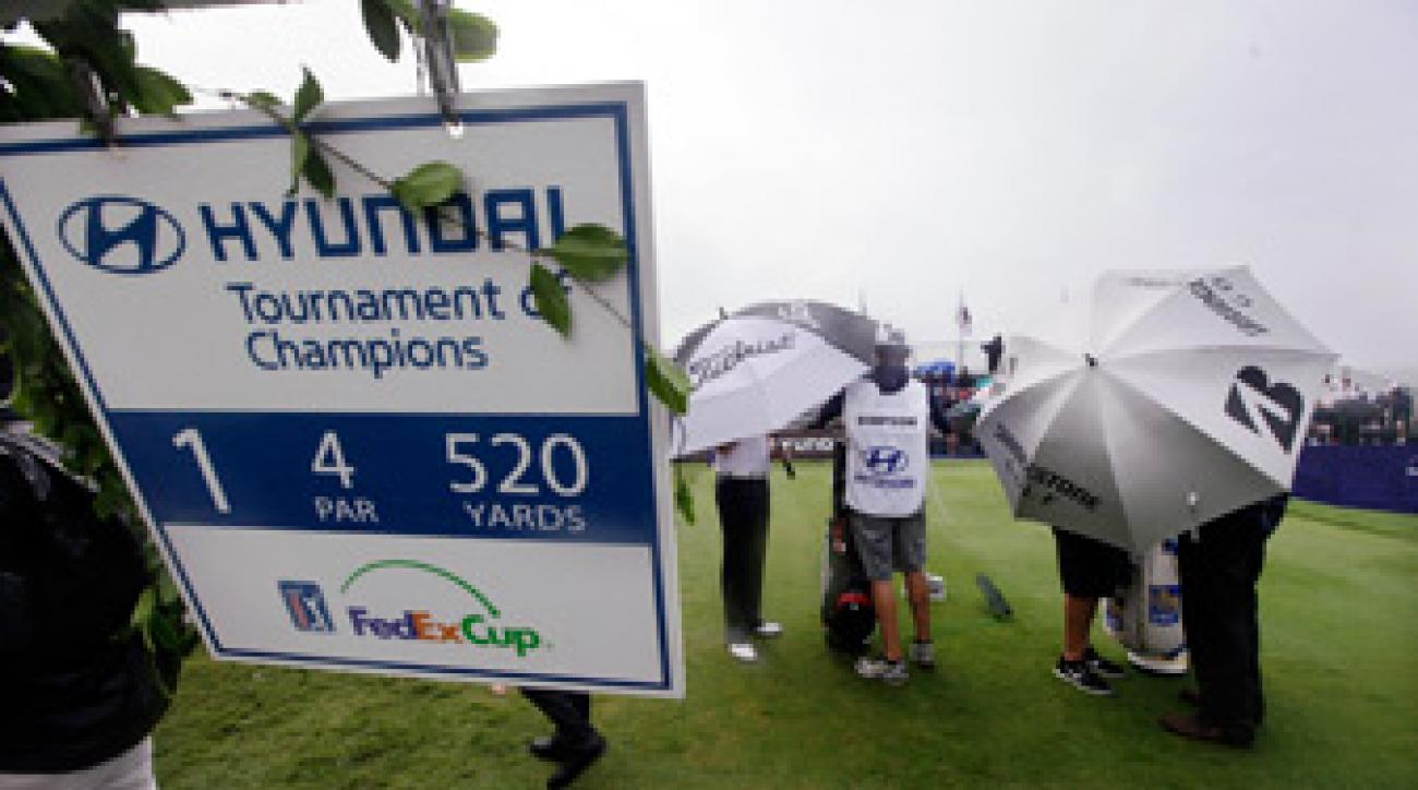 Play was suspended after wind and rain made conditions unplayable on Thursday.