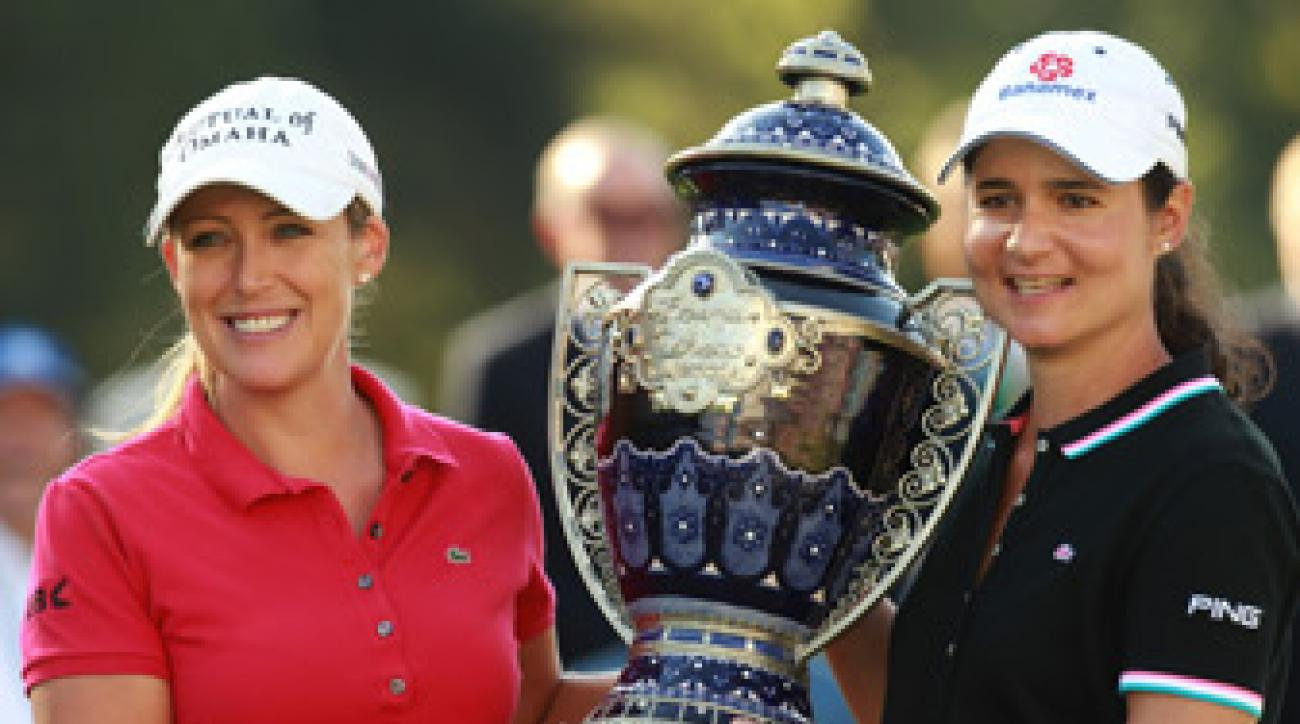 Cristie Kerr, left, received the trophy from tournament host Lorena Ochoa.