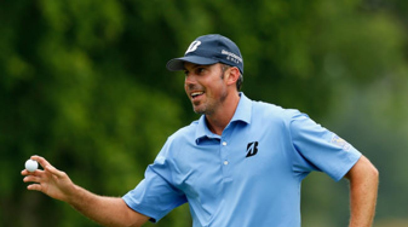 Matt Kuchar made three pars Saturday morning as he completed the rain-delayed second round.