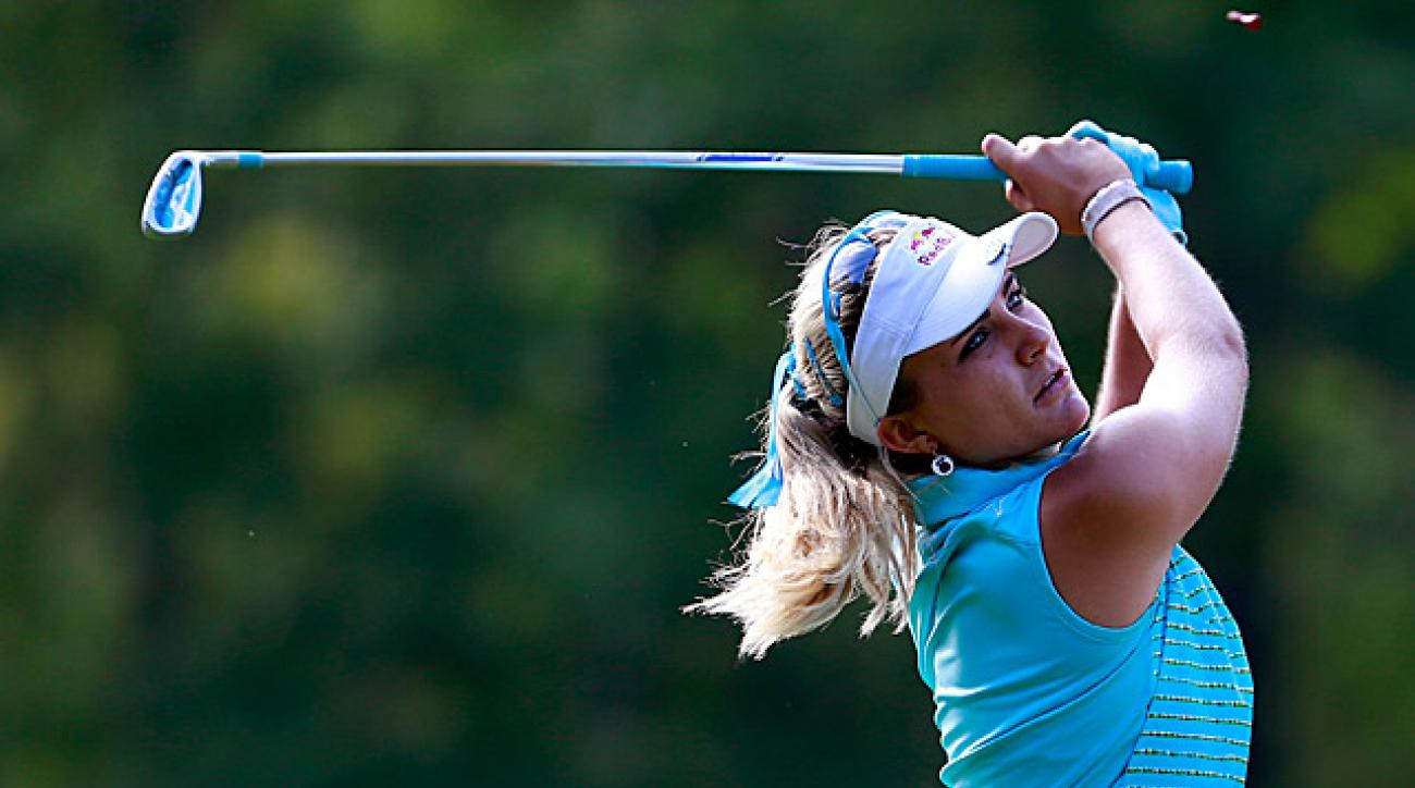 Lexi Thompson shot a 65 for a share of the lead.