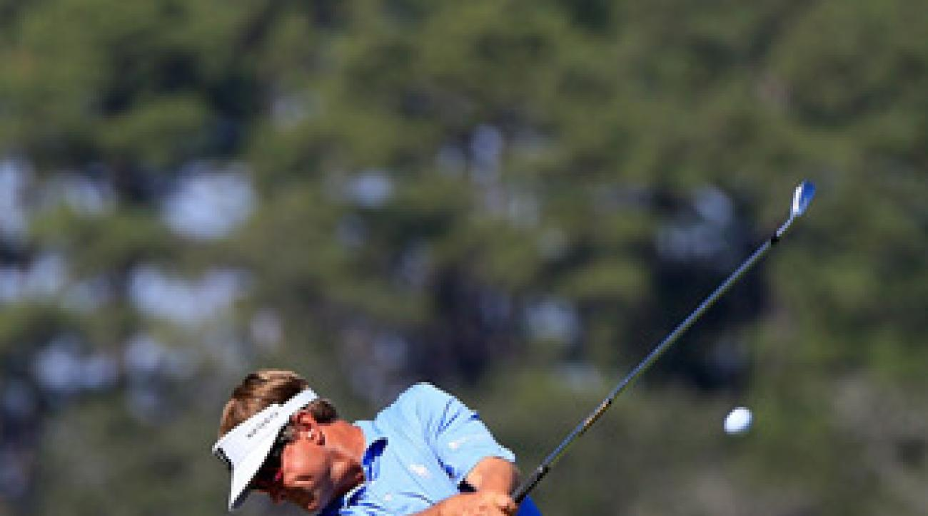 Davis Love III birdied 18 to grab a share of the lead.