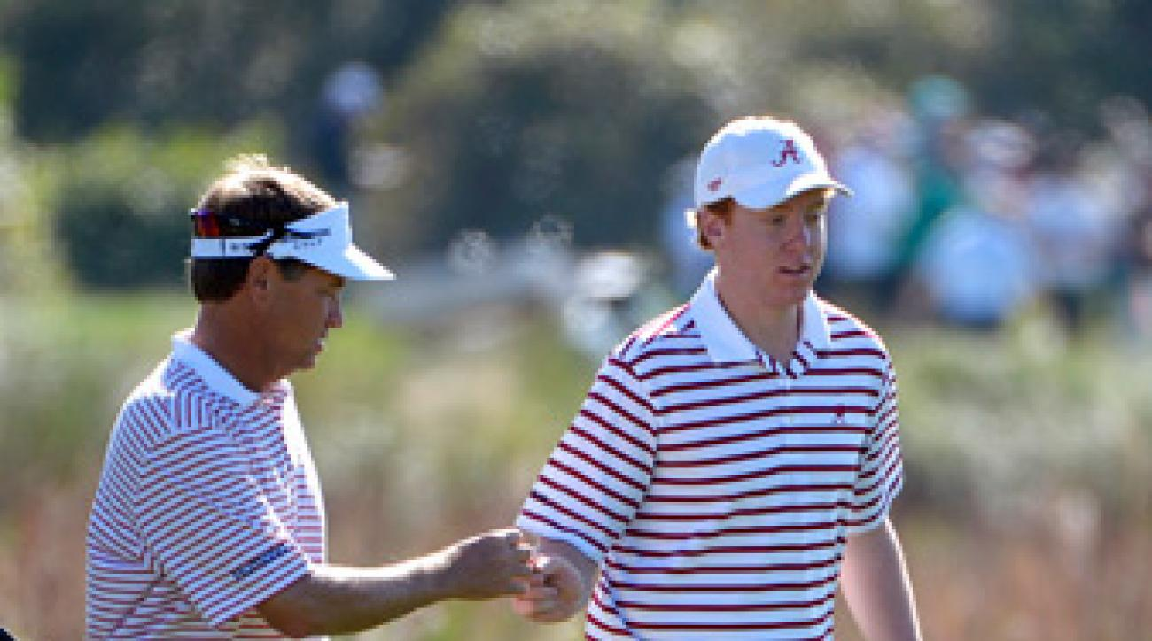 Davis Love III, left, and his son Dru shot a 60 in the scramble format Saturday.