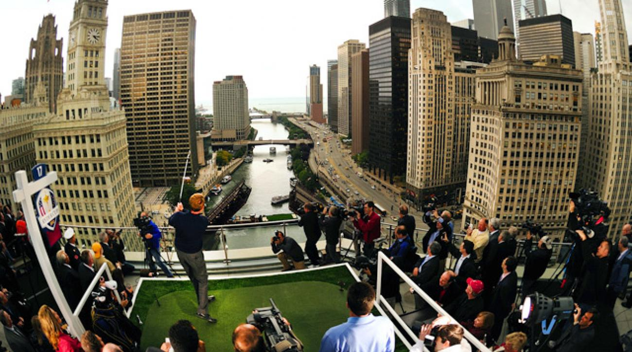 In the Windy City to promote the Ryder Cup, U.S. captain Davis Love III launched an iron shot toward a green on a barge in the Chicago River.