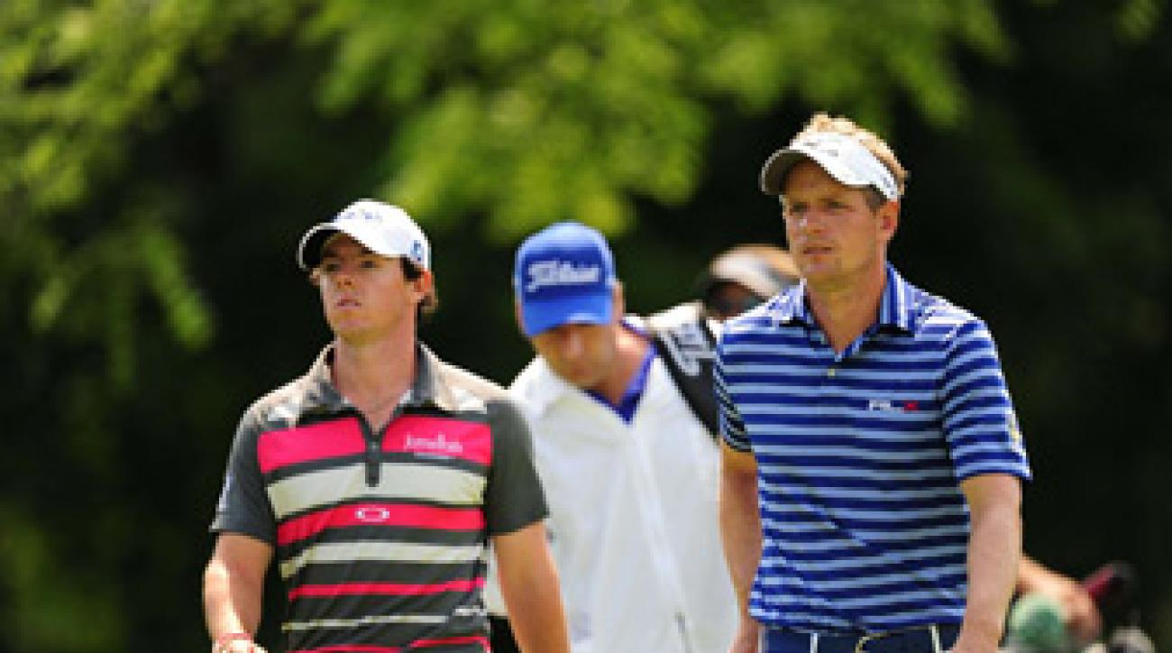 Luke Donald, right, and Rory McIlroy both shot 71s Thursday.