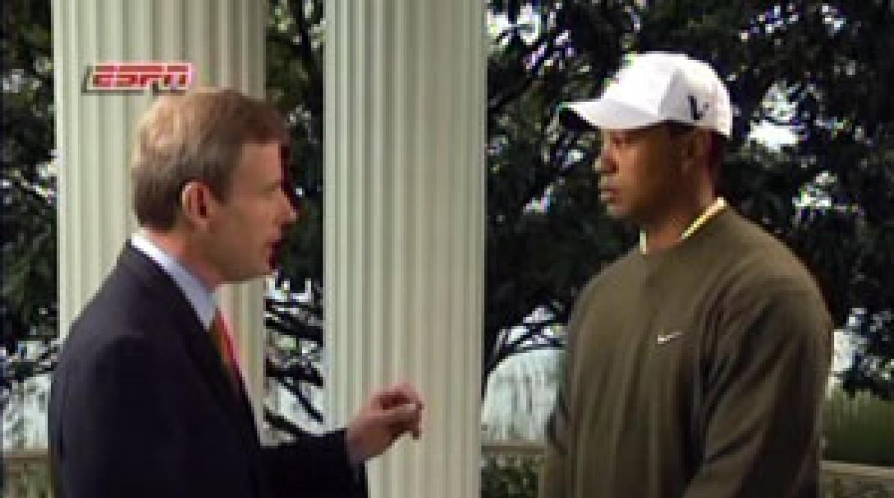 Tiger Woods, right, conducted a five-minute interview with ESPN's Tom Rinaldi on Sunday.