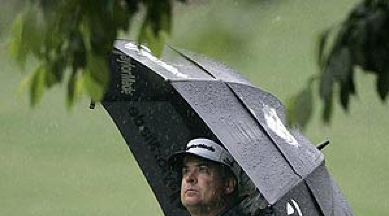 Perry shot a bogey-free 66 in rainy conditions.