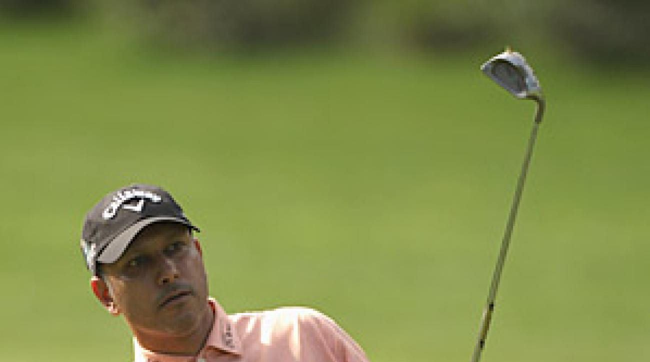 Jeev Milkha Singh is one shot behind leader Scott Jamieson.