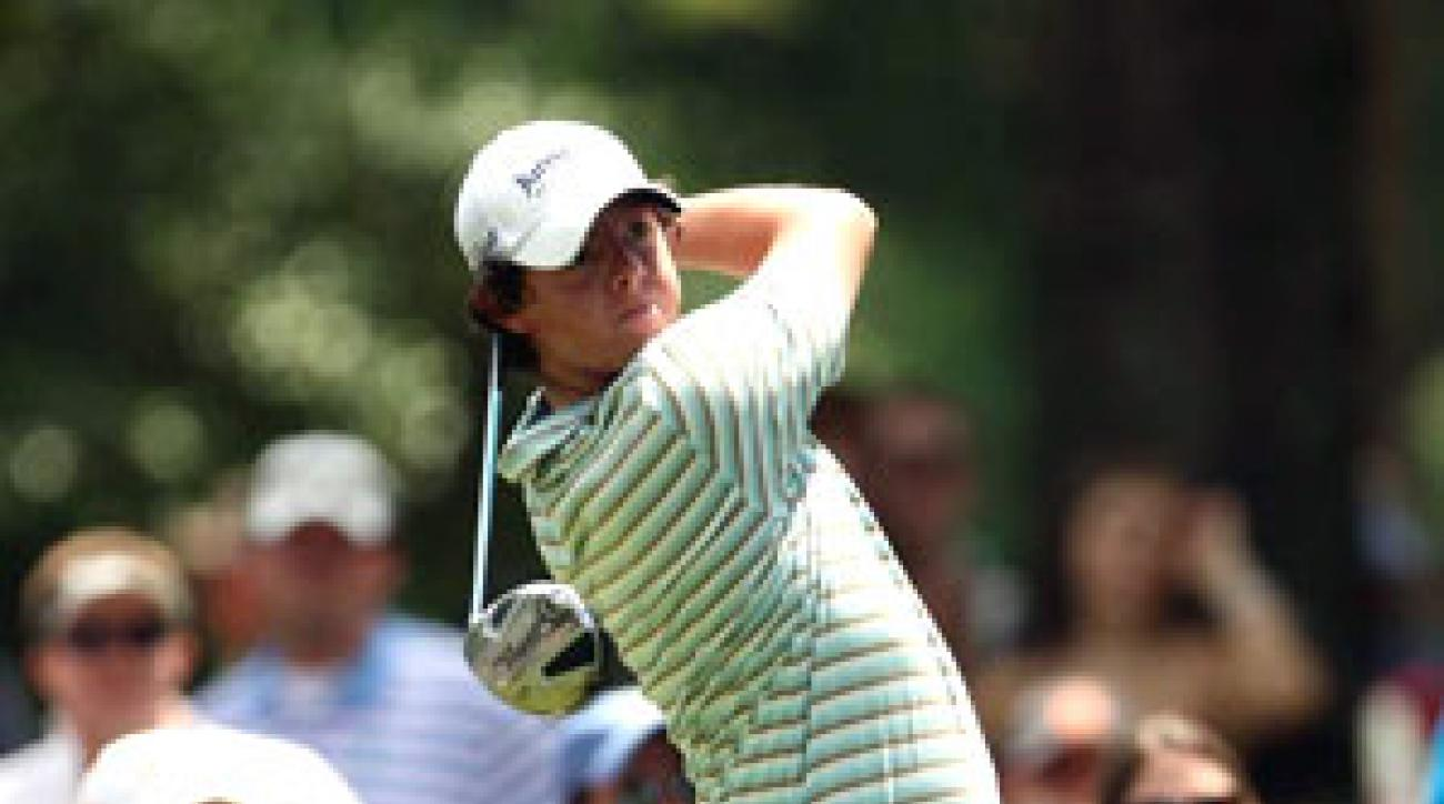 McIlroy's back-nine 30 and four-shot win led to a fist pump on the 18th.