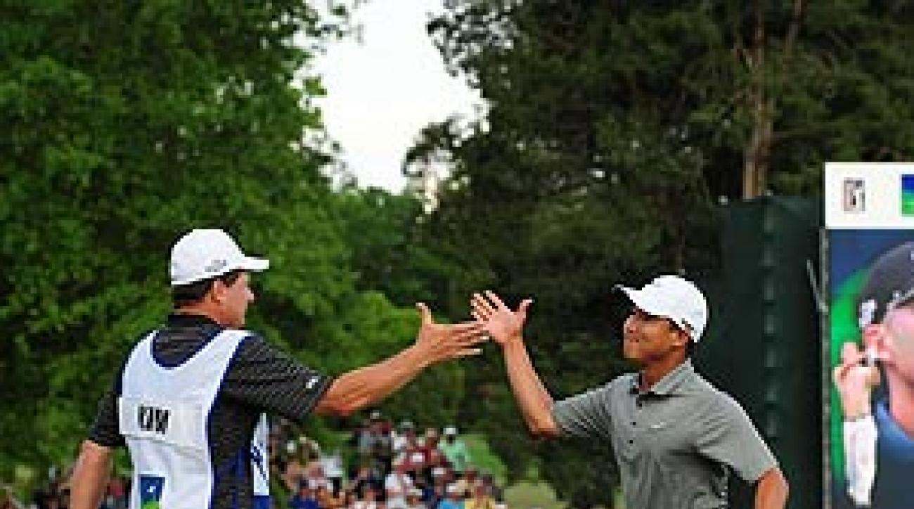 Anthony Kim and his caddie during Kim's Wachovia Championship victory.