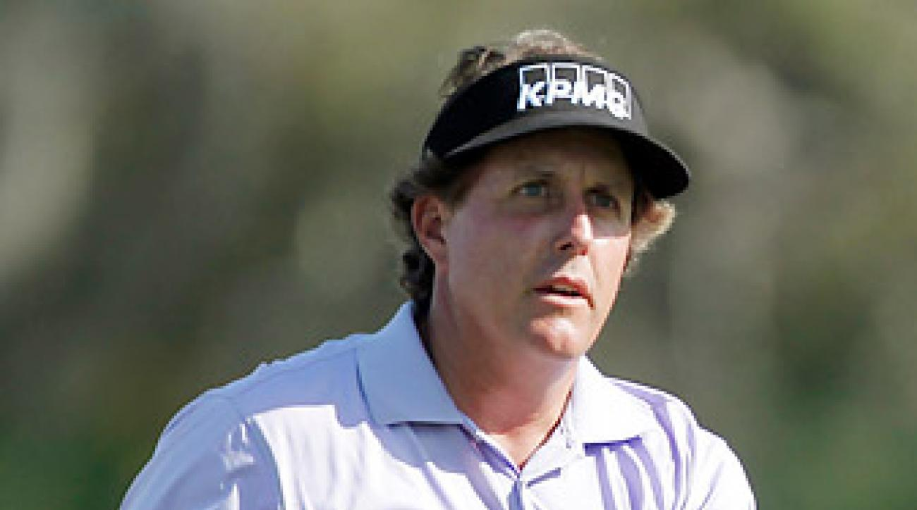 Phil Mickelson completed his first round Friday, finishing with a seven-under 65.