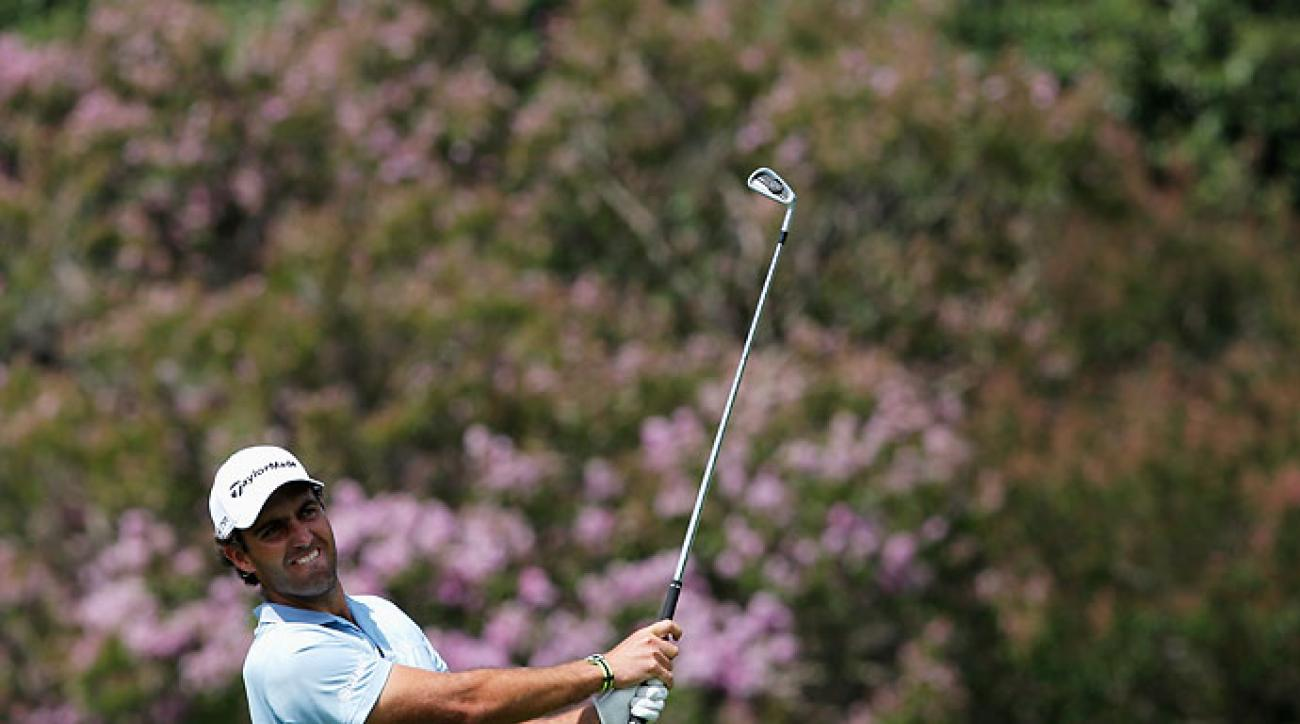 Edoardo Molinari hits his second shot on the 18th hole during Day Two of the Joburg Open at Royal Johannesburg and Kensington Golf Club in South Africa on Friday.