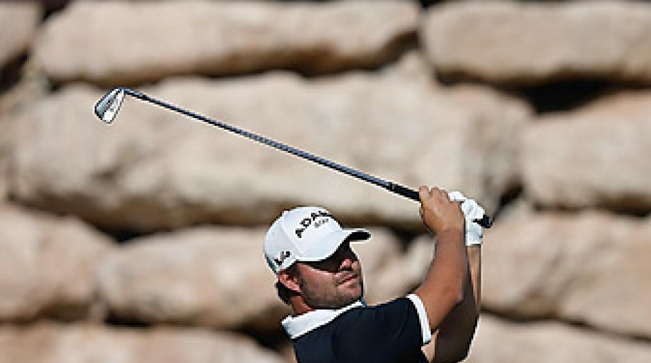 Ryan Moore shot a 10-under 61 to take the lead.