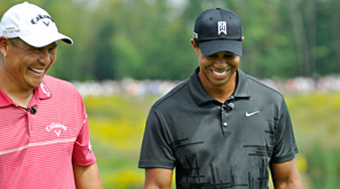 Tiger Woods, right, will once again play in Notah Begay's charity tournament in August.