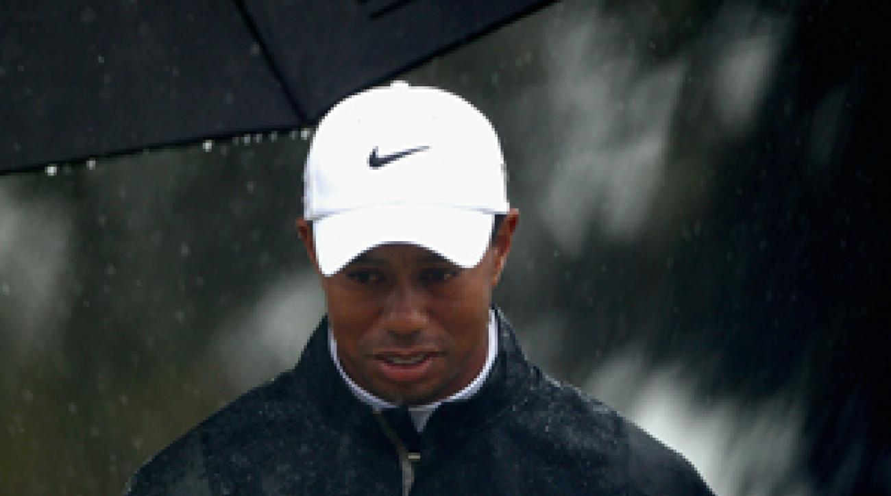 Tiger Woods shot an even-par 71 in heavy rain on Saturday.