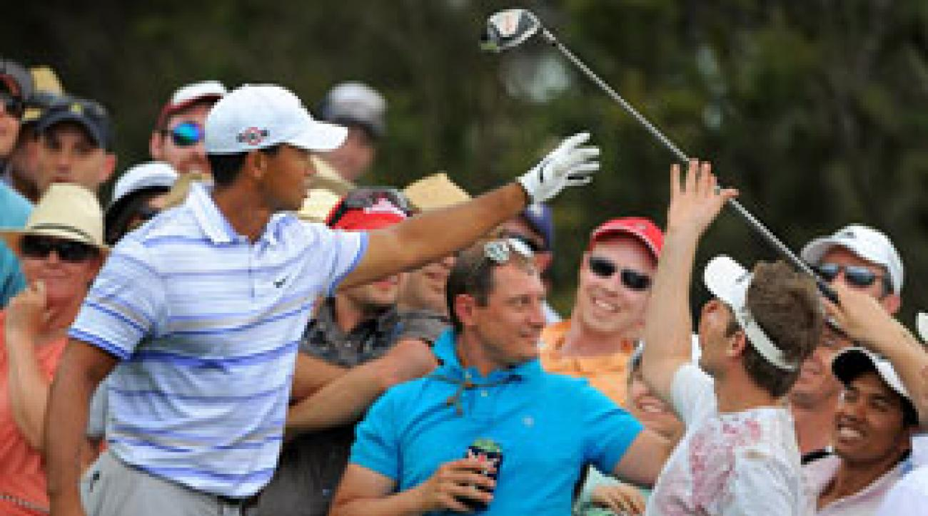 Tiger Woods retrieved his driver from the crowd on No. 13 Saturday at Kingston Heath.