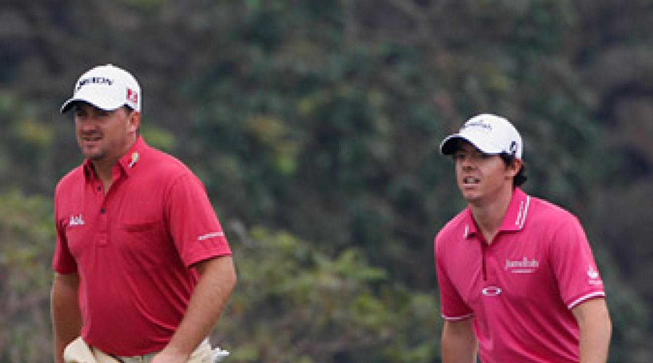 Graeme McDowell and Rory McIlroy are two back at the World Cup after the first round.