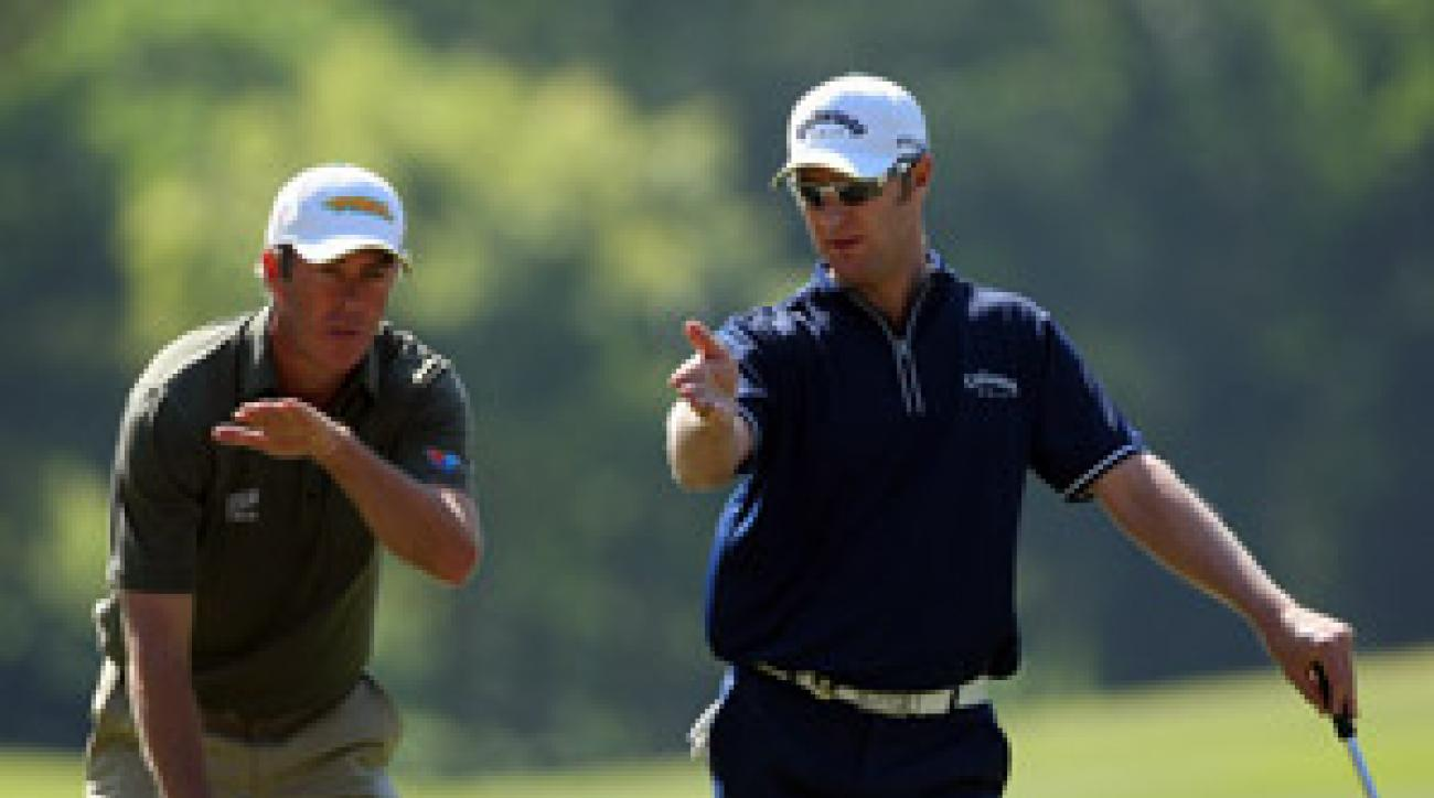Richard Green, left, and Brendan Jones of Australia tied Spain for the lead at the World Cup of Golf.