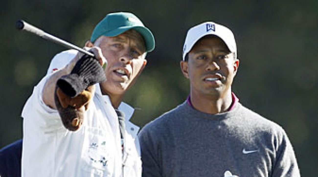 Steve Williams, left, caddied for Tiger Woods for 13 or his 14 major wins.