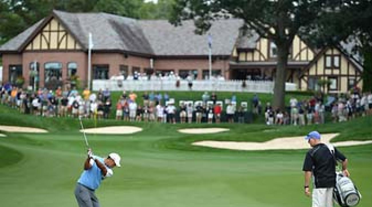 Tiger Woods hits a shot into 18 at Oak Hill Country Club in Upstate New York, a classic, old-time course like the year's three previous major venues.
