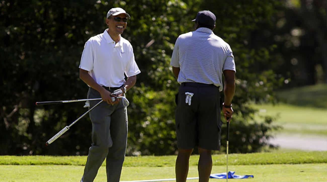 President Barack Obama and Ahmad Rashad at the Farm Neck Golf Club on Aug. 9, 2014 in Oak Bluffs, Mass.