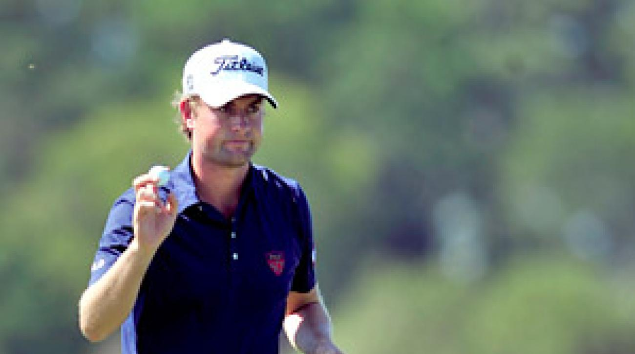 Webb Simpson fired a seven-under 63 in the opening round to take the lead.