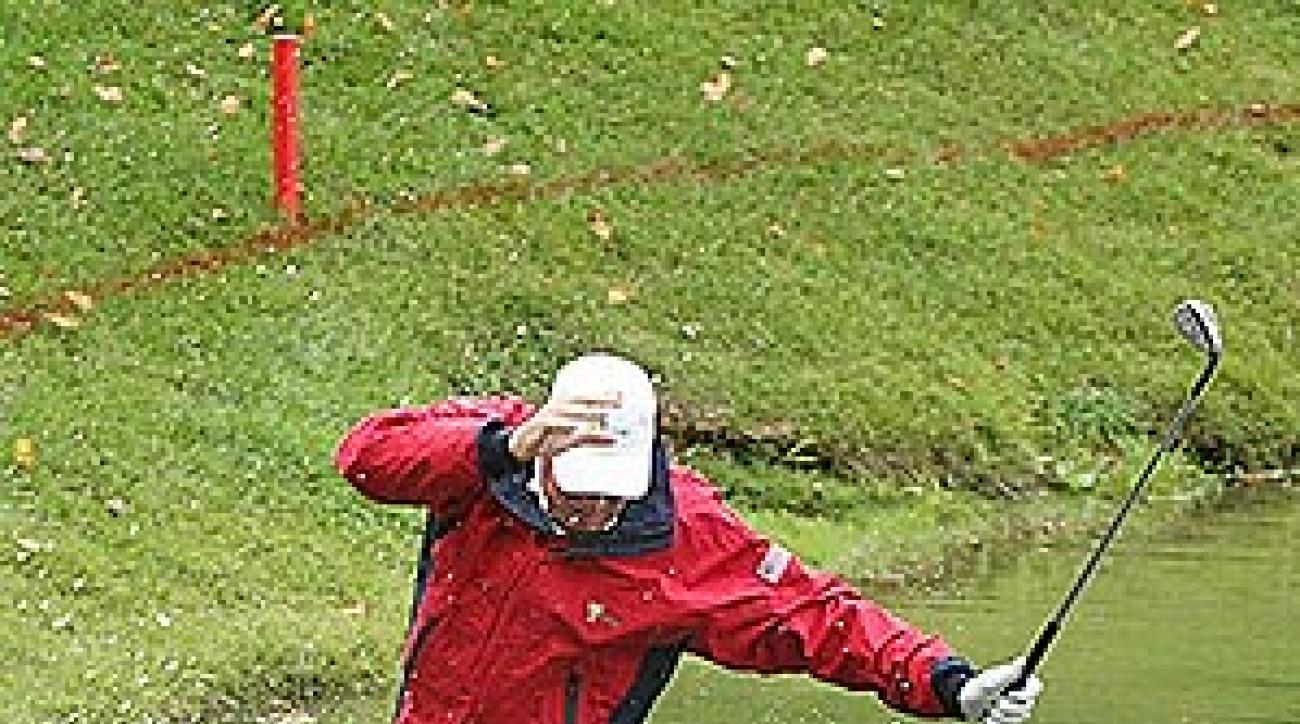 """Woody Austin provided one of the most memorable moments of the 2007 Presidents Cup when he <a href=""""http://www.golf.com/golf/gallery/article/0,28242,1666793,00.html"""">fell face first into the water after trying to play his ball out of the hazard</a>."""