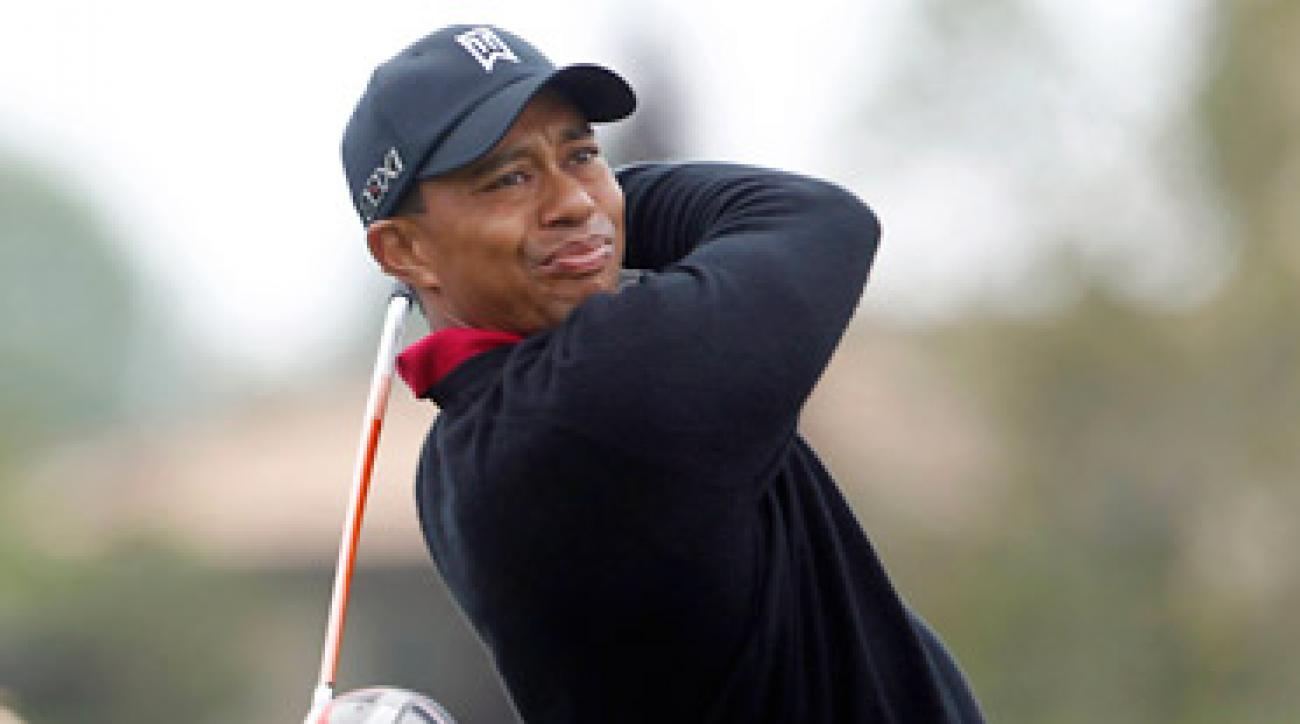 A fan threw a hot dog at Tiger Woods on the seventh green on Sunday.