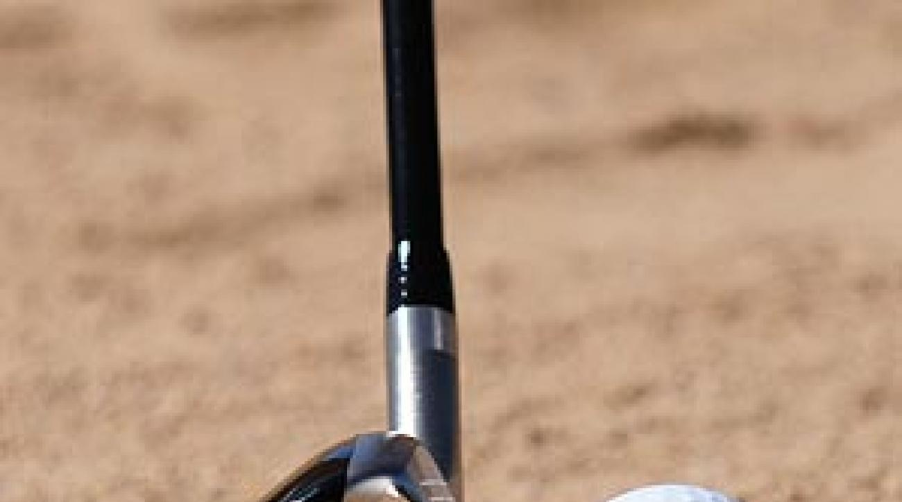 Stand taller at address so that the leading edge lines up with the ball's equator.