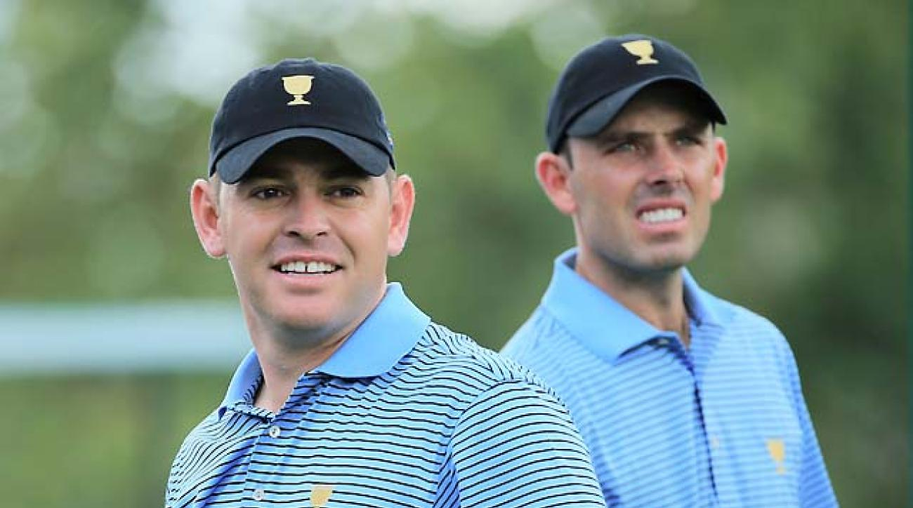"Louis Oosthuizen and Charl Schwartzel cover their ""closely mown"" heads after the team barber gave them a close shave at the 2013 Presidents Cup."