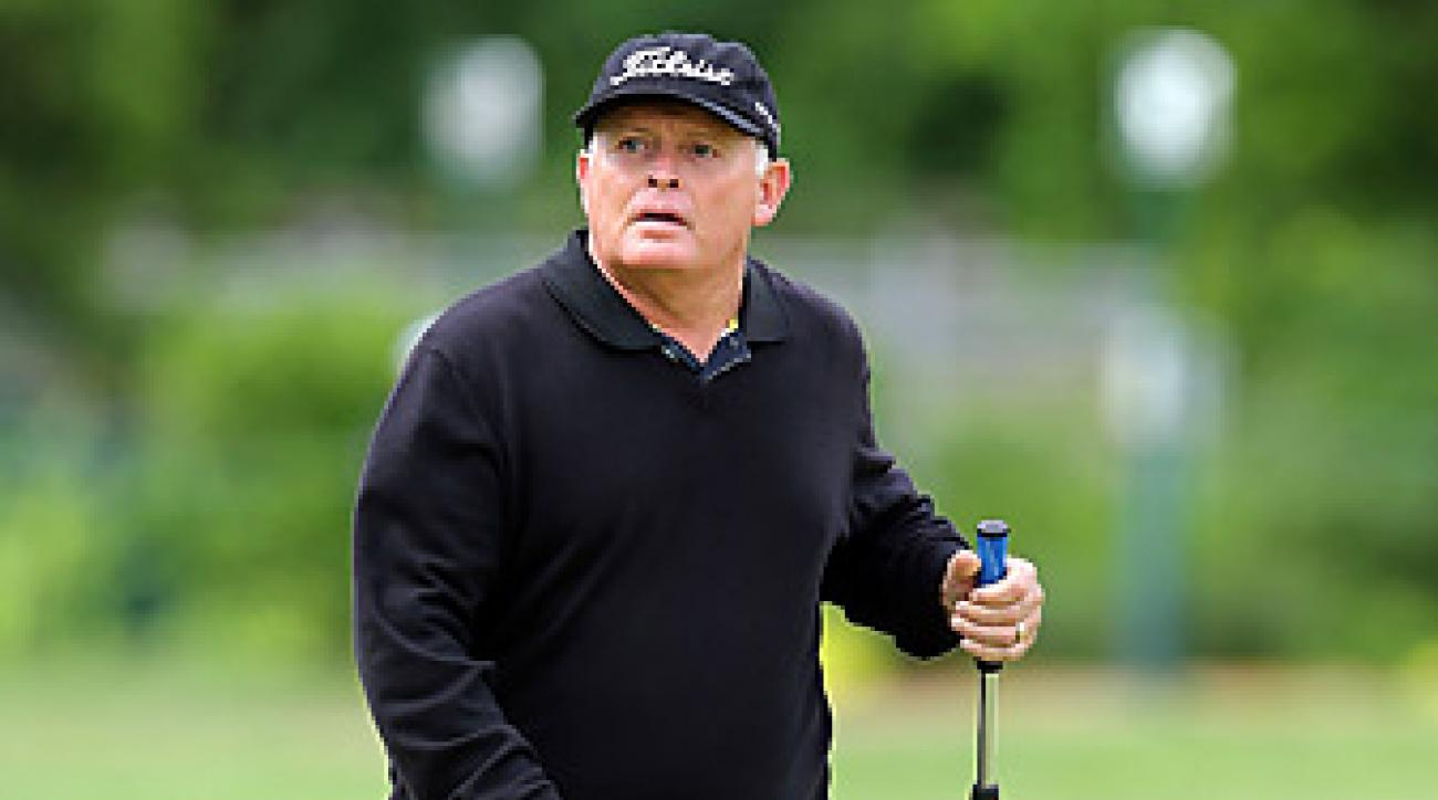 Peter Senior, shown here playing in Round 1 at the Senior PGA Championship, began using a long putter in 1989.