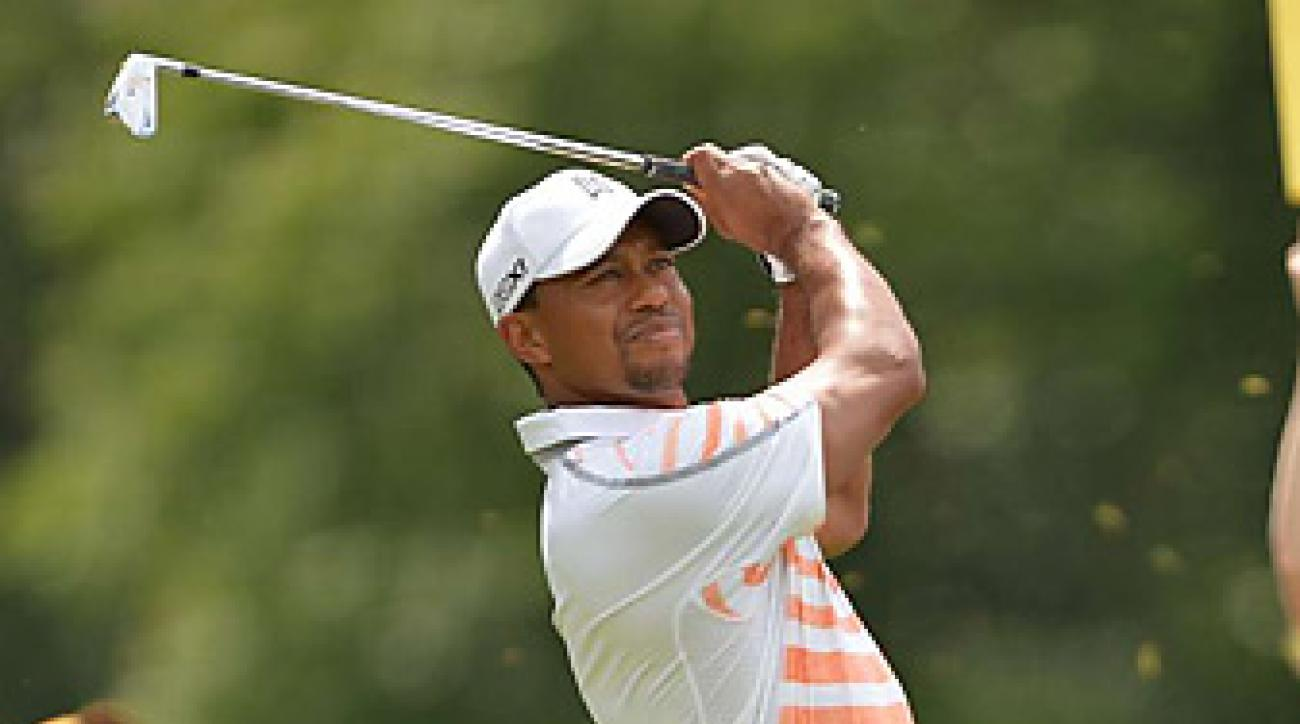 Tiger Woods finished off his opening round Friday morning, then shot a second-round 70 in the afternoon.