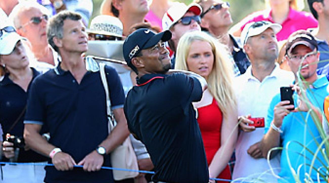Tiger Woods fell to Charl Schwartzel in his opening match in Turkey.