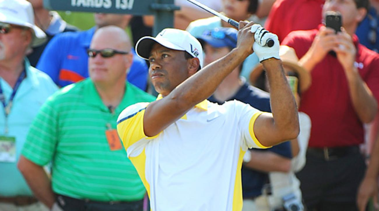 Tiger Woods, shown here at a Players Championship practice round, is still answering questions about his controversial two-shot penalty at the Masters.