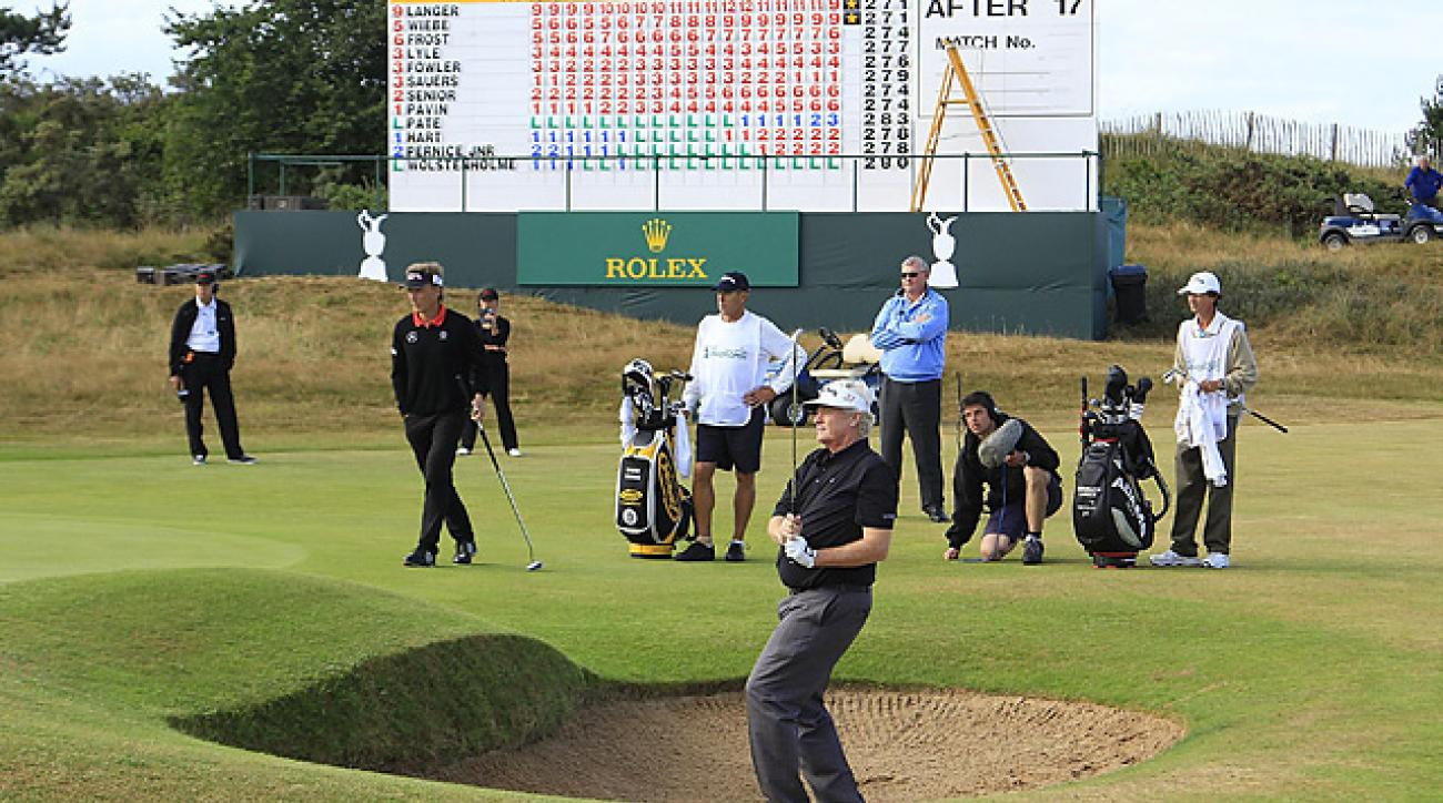Mark Wiebe (in bunker) beat Berhard Langer (background) with a par on the fifth hole of sudden death.