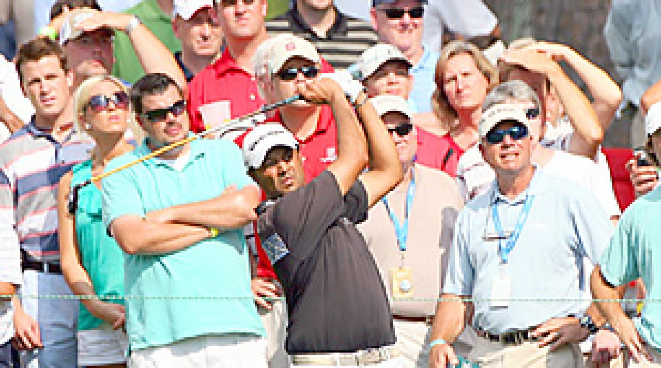 Arjun Atwal used a hybrid out of the rough on the 18th hole to set up his first career PGA Tour win.