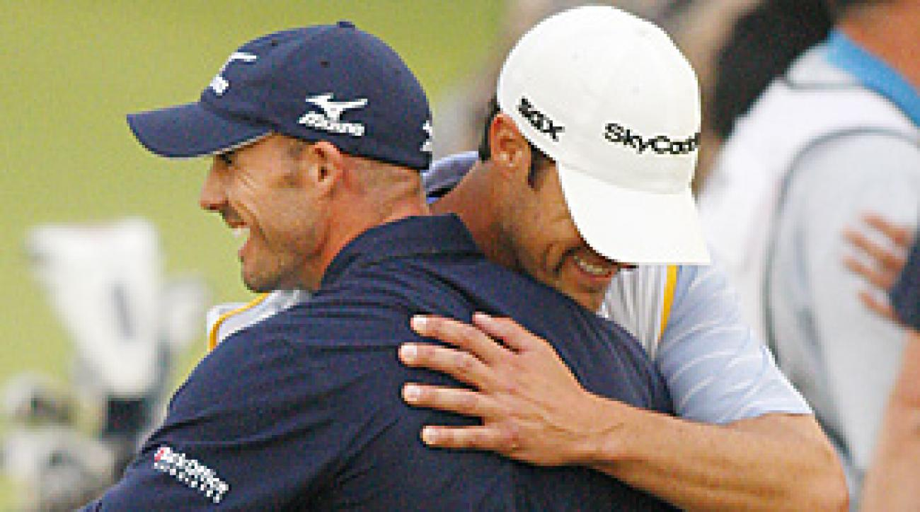 Jonathan Byrd hugged his caddie moments after his improbable ace won the Justin Timberlake Shriners Hospitals for Children Open.