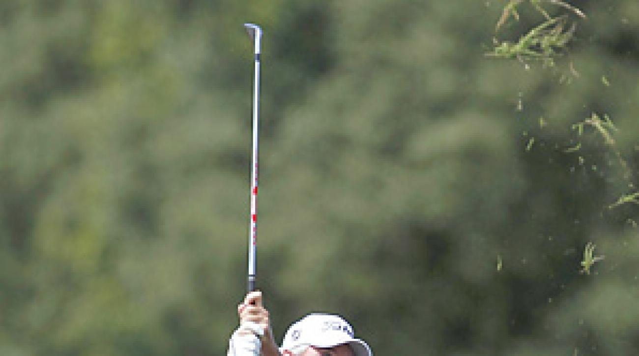 Russ Cochran shot a six-under 66 to claim the first round lead.