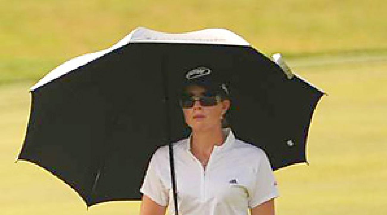 Paula Creamer battled the heat, and a heavily wrapped thumb, during the opening round at Oakmont.