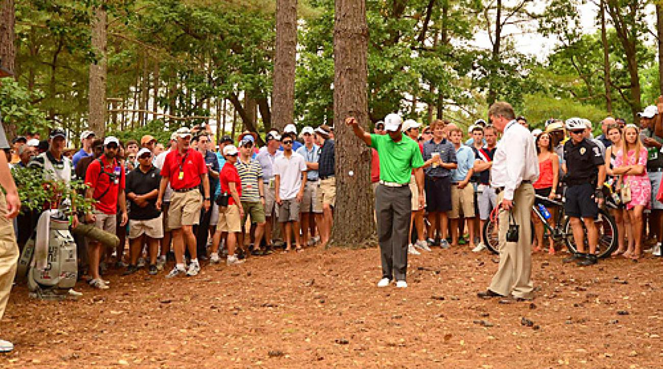 The strange moments from Tiger's two days at Quail Hollow included this free drop at the fifth hole on Friday, which led to a par on the hole.