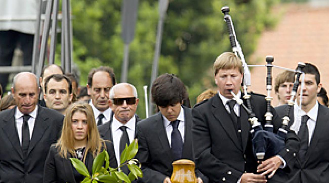 Ballesteros's eldest son, Javier, carried his father's remains while leading the procession to the church.