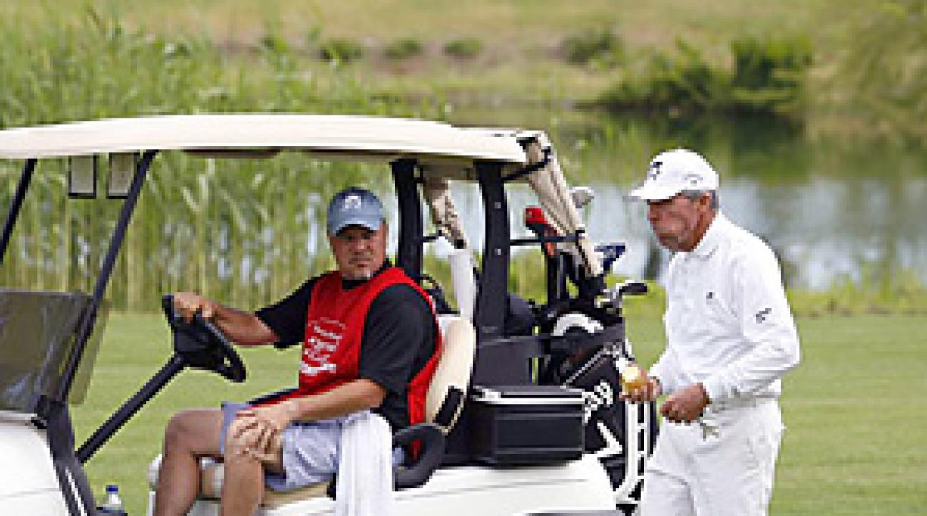 Still at fitness nut at 74, Gary Player kept up with his motorized caddie -- and later won the event.