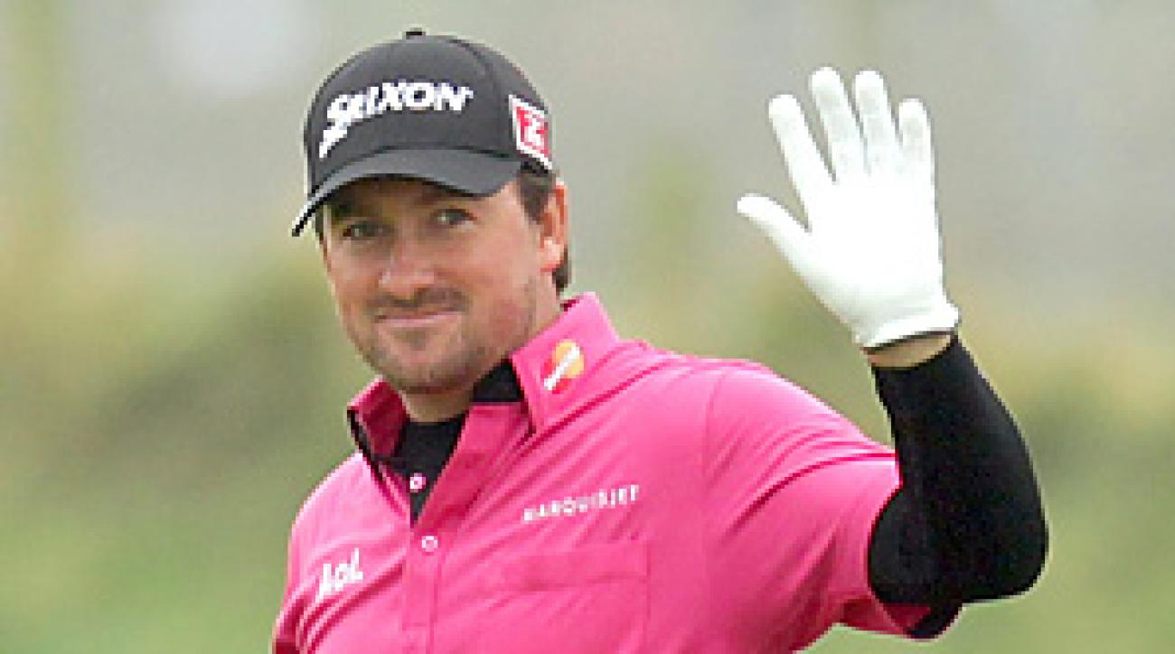 Graeme McDowell trails countryman Michael Hoey by three shots through three rounds at the Dunhill Links.