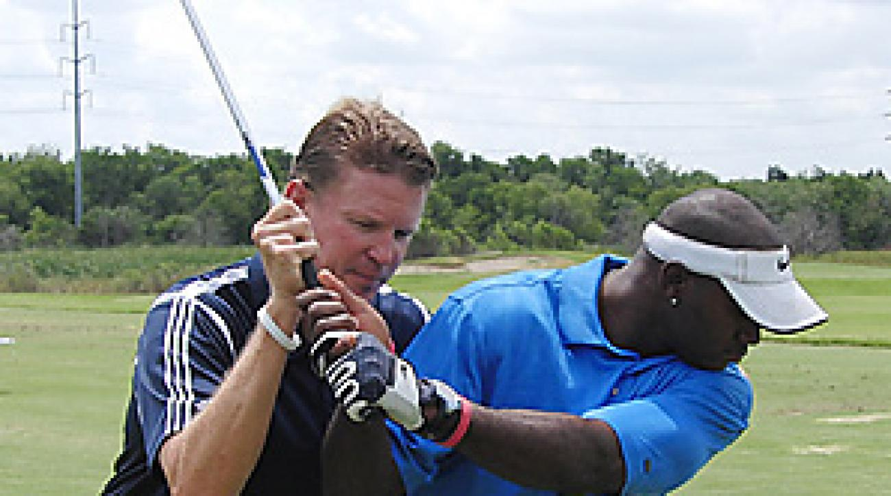 Shawn Humphries (shown here working with Dallas Cowboys defensive back Terence Newman) is the director of instruction at Cowboys Golf Club.