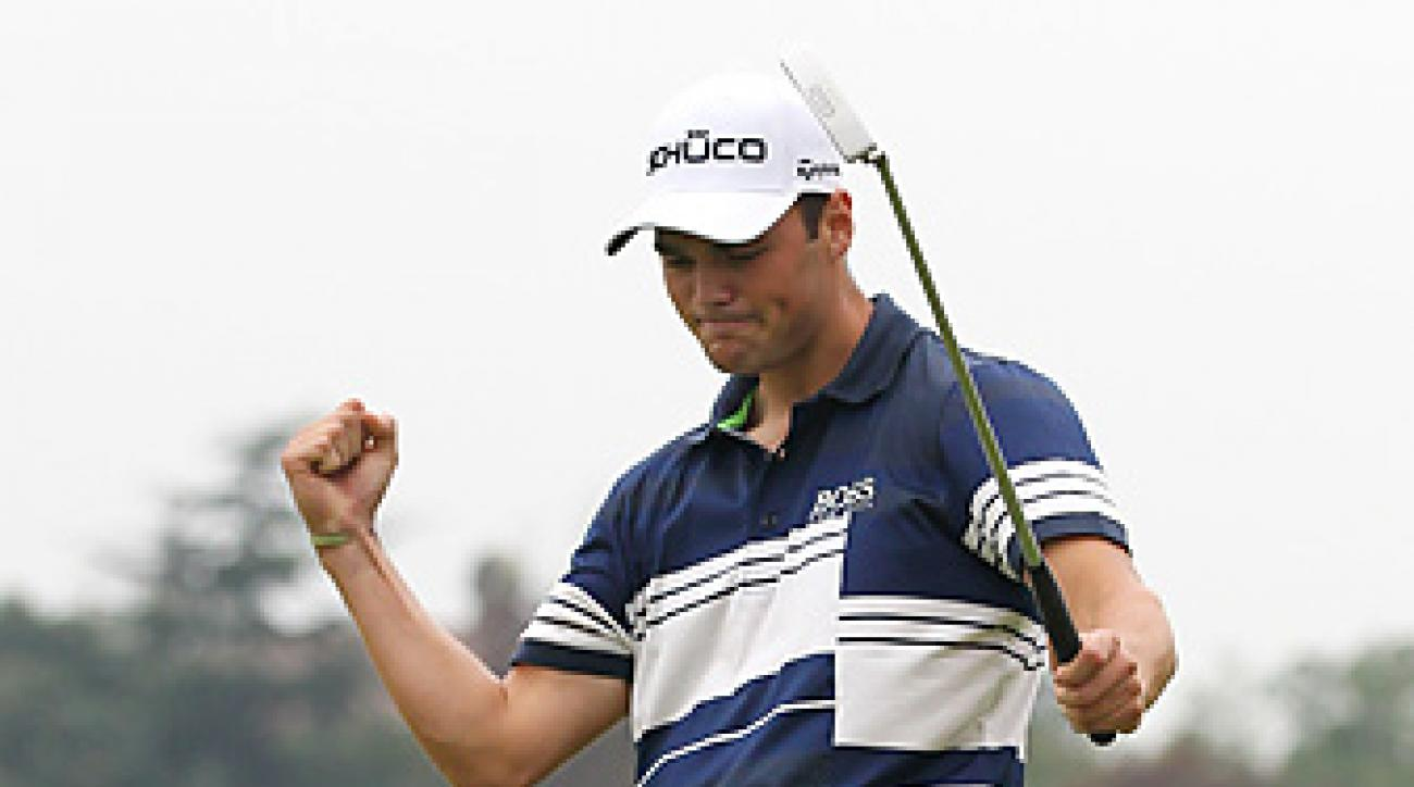 Martin Kaymer birdied nine of his last 12 holes to rally in Shanghai.