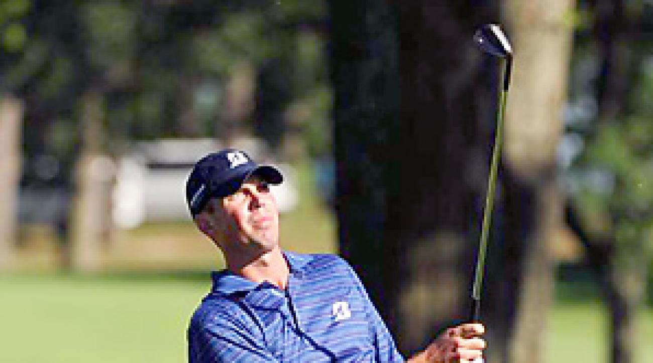 Matt Kuchar birdied the first hole of sudden death to beat Martin Laird.